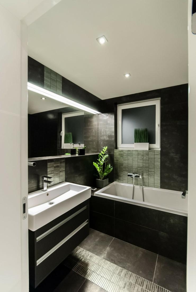 Темный монохромный интерьер ванной