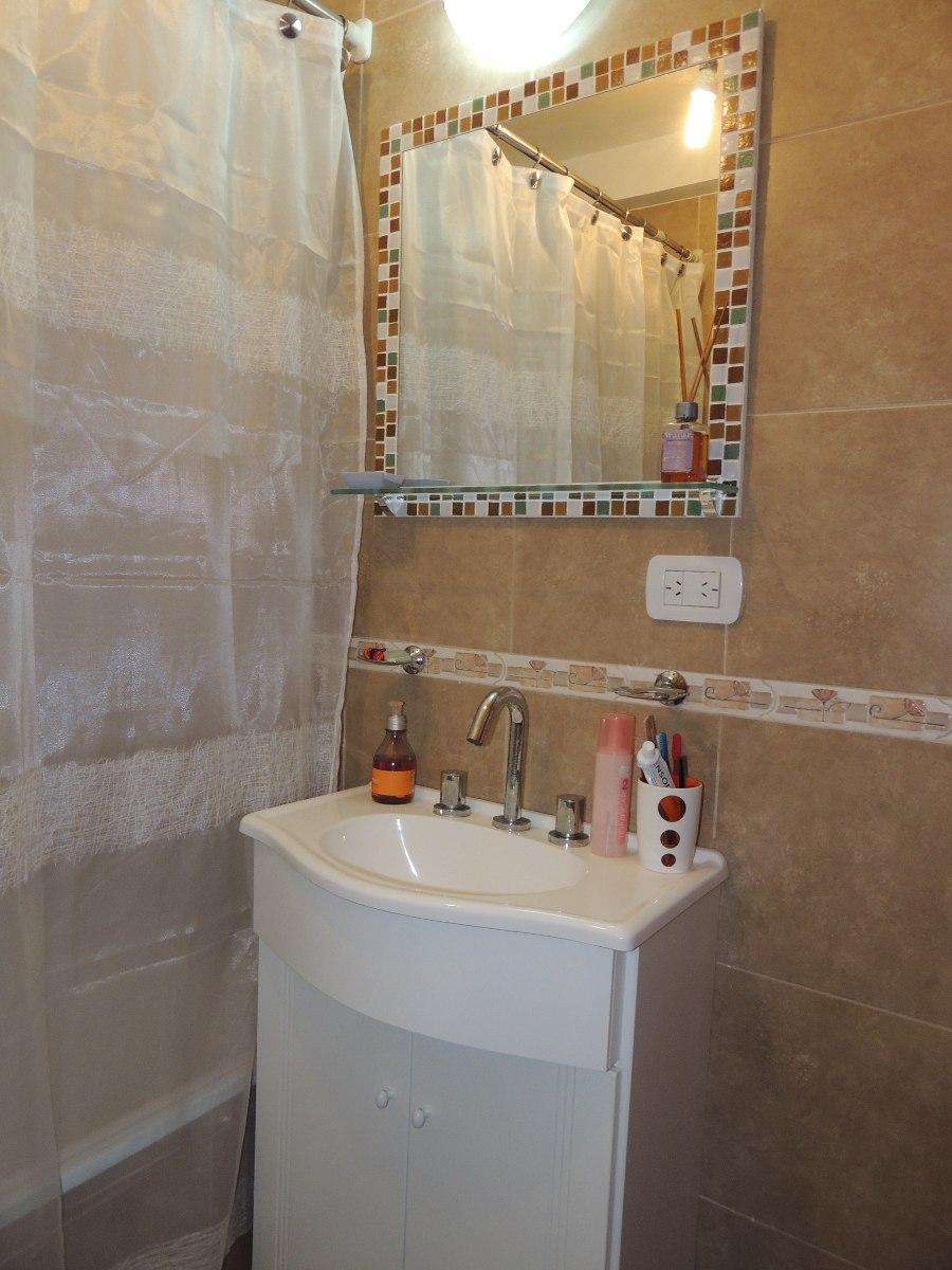 Зеркало в ванную с рамой из мозаики