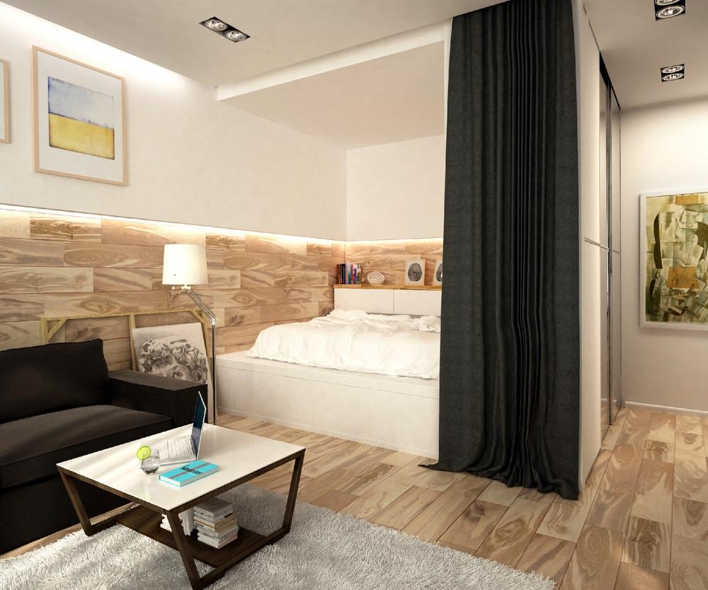 Спальня в однокомнатной квартире с текстильной перегородкой