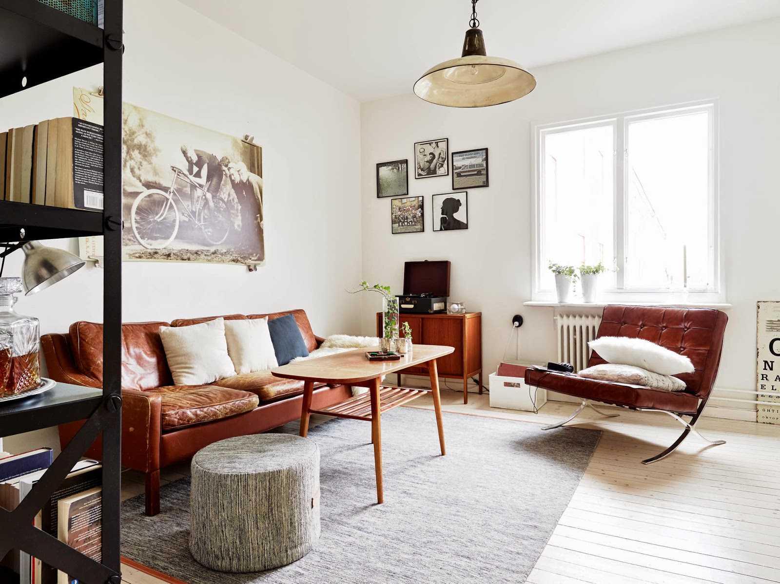 Однокомнатная квартира в скандинавском стиле с кожаной мебелью